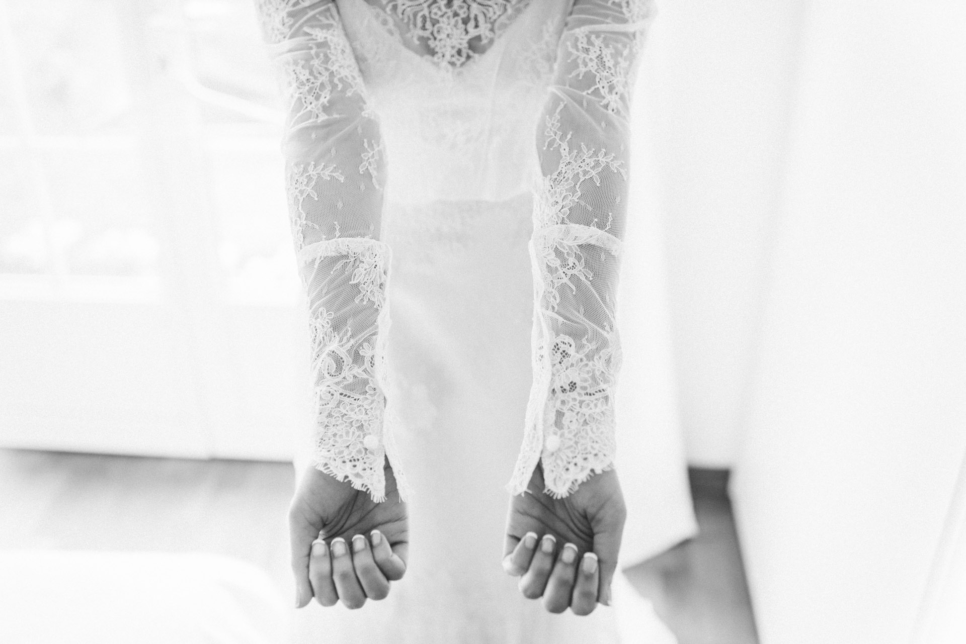 The arms in the bride's dress